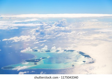 in polynesia moorea the view of the reef from the airplane cloud and ocean