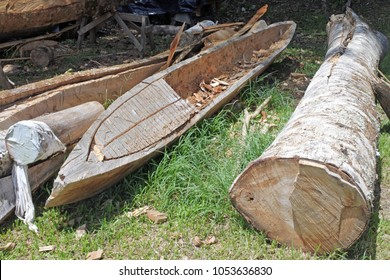 Polynesian canoe carving craft from a single timber tree log in Rarotonga, Cook Islands.Traditional Polynesian navigation was used for thousands of years to make long voyages across the Pacific Ocean.