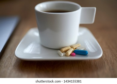 Polypharmacy. Combining suplements and medicines with coffee. Daily dose of capsules and pills.