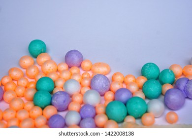 Polystyrene foam pellets Polystyrene foam, orange, green, purple