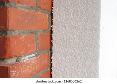 polystyrene insulation panel on brick wall
