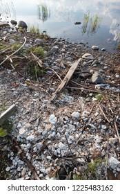 Polystyrene, styrofoam garbage on the shore.