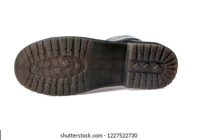 polyurethane shoe sole, black boot bottom view. Close-up. Isolated on white