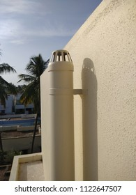 Polyvinyl chloride known as PVC pipes made for setting up chimneys to let out the unwanted smoke or air from inside a house and seen with the shadow of the pipe