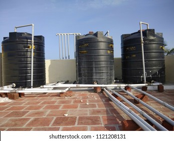 Polyvinyl chloride PVC water pipes connected to unidentified overhead tank forming abstract of lines or pattern seen with metal valves for closing and opening the water flow water scarcity chennai ind