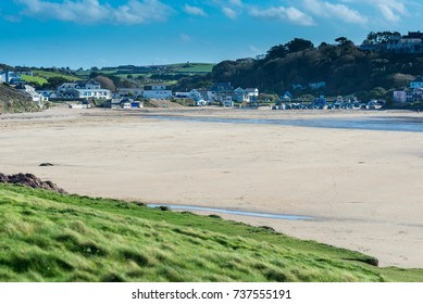 Polzeath beach is a natural sandy bay leading to Padstow Bay and the North Atlantic. The beach is a gentle slope and very popular with surfers and tourists