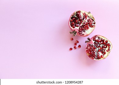 Pomegranate. Fresh ripe pomegranate overhead light pink background. Top view, copy space