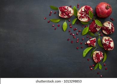 Pomegranate and freshly squeezed pomegranate juice on a vintage background. Top view, background.