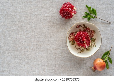 Pomegranate fruit on cotton fabric background with copy space.