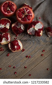 Pomegranate fruit on a wooden surface. Flat lay