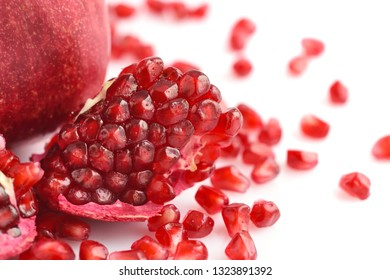 Pomegranate fruit with seeds isolated on white background