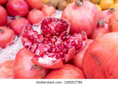 The pomegranate is a fruit-bearing deciduous shrub or small tree in the family Lythraceae that grows between 5 and 10 m tall. The fruit is typically in season in the Northern Hemisphere from September