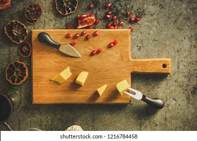 pomegranate grain, cheese and honey - appetizer on a slate plate on a wooden background. top view.