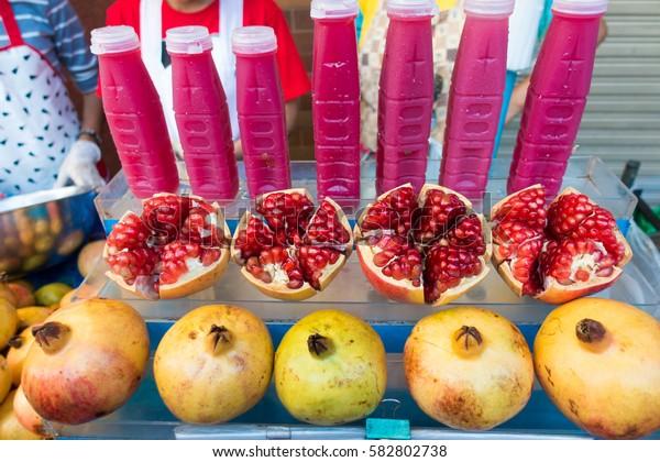 pomegranate juice and pomegranate fruit, street food ,Bangkok Th