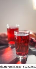 Pomegranate juice in a glass and ripe pomegranate.