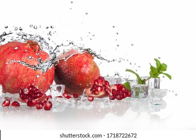 pomegranate with mint and lemon with splashing water and ice