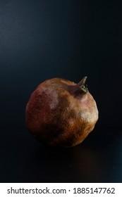 pomegranate on a dark background