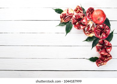 Pomegranate. On a white wooden background. Top view. Copy space.