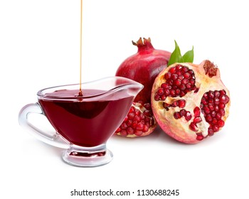 Pomegranate sauce in a glass bowl. Isolated on white background.