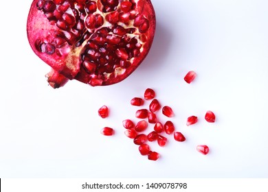 Pomegranate seeds and Beautiful ripe pomegranate on white background with place for copy space.