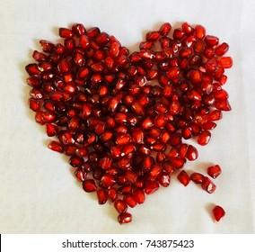 Pomegranate seeds in heat shape