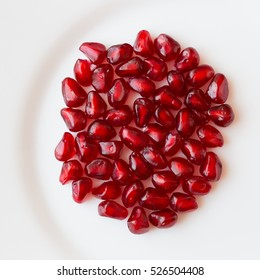 pomegranate seeds on a white plate