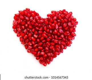 pomegranate in a shape of a heart on white background