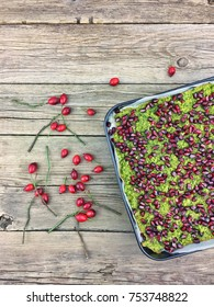 Pomegranate and spinach cake on a wooden table