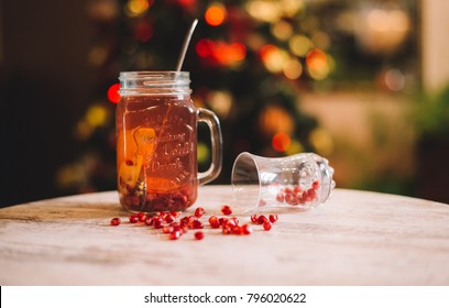 Pomegranate Tea, Fruits and Pomegranate Seeds on Wood Board. Healthy Pomegranate Tea in the White Cup. Food and Drinks Photo Collection.