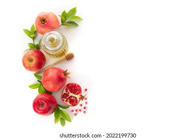 Pomegranates, apples and honey on white background, traditional food of Jewish New Year - Rosh Hashanah.Top view. Copy space background