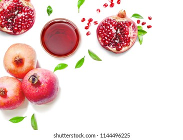pomegranates and juice glass wallpaper