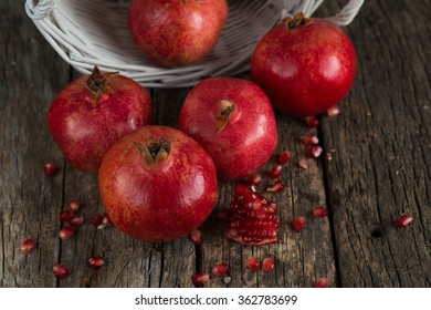 Pomegranates on a old wooden table
