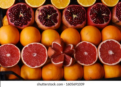 Pomegranates, oranges and grapefruits on the street market of Istanbul, Turkey. The fresh juice sellers are almost in every corner when you walk around the bazaars and streets of the country