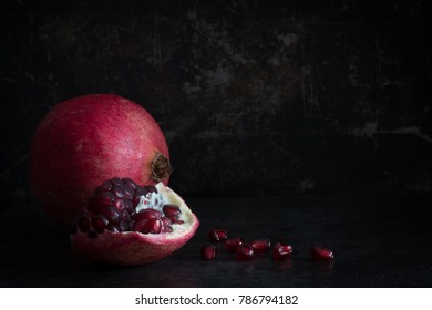 Pomegrante on a Dark Background with Copy Space Horizontal