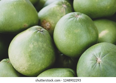 The pomelo, Citrus maxima, or Citrus grandis, is a natural citrus fruit, similar in appearance to a large grapefruit, native to South and Southeast Asia.