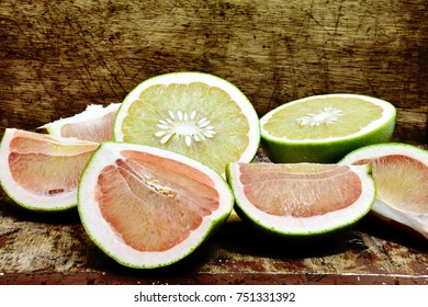 Pomelo half cut   on the wooden table