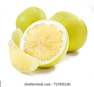 Pomelo with half of it isolated on the white background raw food