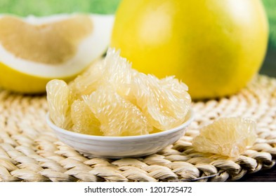 The pomelo (shaddock), citrus maxima or citrus grandis, pomello, pummelo, pommelo, pumelo is the largest citrus fruit from the Rutaceae family. Different size pieces on table, studio set.