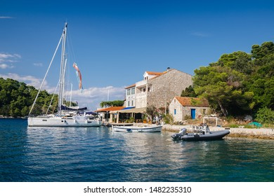 Pomena, Mljet island, Croatia - August 4, 2019: boats at the harbor, Mljet national park.