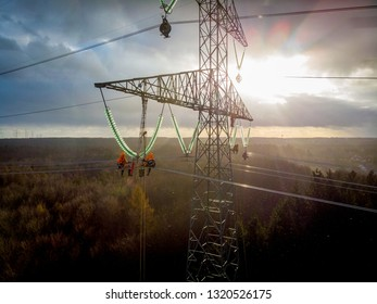 POMERANIA DISTRICT,POLAND - DECEMBER 8,2018:  Aerial view of electricians working on electric poles to install and repair power lines.