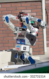 POMONA, CA - JUNE 6: Team KAIST's DRC-Hubo robot successfully rolls through rubble at the DARPA Robotics Challenge in Pomona, CA on June 6, 2015. The Korean robot went on to win the competition.
