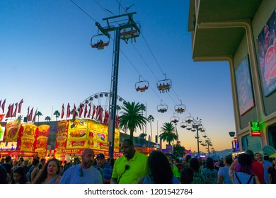 Pomona, California USA - September 23rd, 2018. Many people come to LA County fair. The street is filled with crowd of people who are enjoying and walking. Cable car is one of popular item in fair.