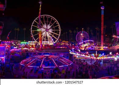 Pomona, California USA - September 23rd, 2018. Aerial view of LA County fair that has many people. The street is filled with crowd of people who are enjoying, walking and eating on night.