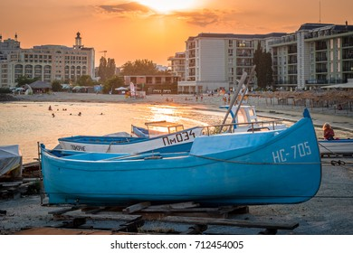 POMORIE, BULGARIA - AUGUST 18, 2017: Boats on the beach. Beautiful sunset.