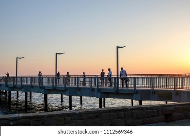Pomorie, Bulgaria - June 12, 2018: Evening walk by the sea.