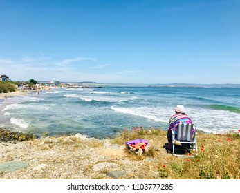 Pomorie, Bulgaria - May 30, 2018: View of the people spending time on the beach.