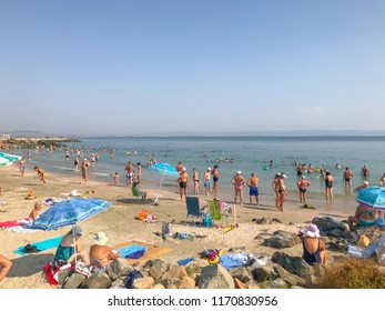 Pomorie, Bulgaria - September 03, 2018: People relaxing on the beach.