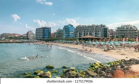 Pomorie, Bulgaria - September 08, 2018: People relaxing on the beach.