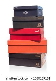Pomos, Cyprus - September 04, 2017: sport shoe boxes. Product shoot of Nike, Salomon,Puma, Kangol  shoeboxes. isolated over white background