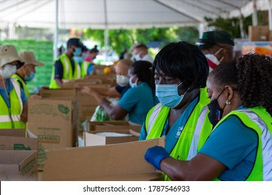 Pompano Beach, Florida, USA - July 30, 2020: Food Distribution with Pompano Beach BSO officers and Pompano Beach Fire Department, volunteers at Pompano Beach Mall parking lot.